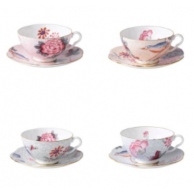 4 teacups with saucers